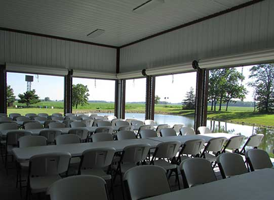 Club banquet hall with the doors open to reveal a beautiful view of the lake.