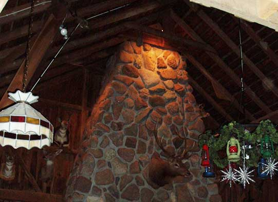 Interior of the lodge featuring the stone fireplace.